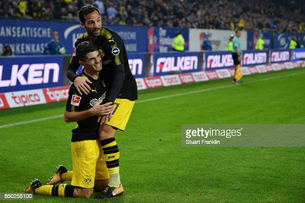 Christian Pulisic of Dortmund celebrates with Gonzalo Castro of Dortmund after he scored his teams third goal to make it 30 during the Bundesliga...