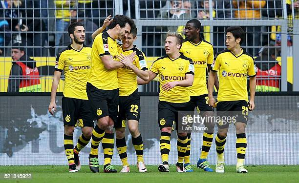 Christian Pulisic of Dortmund celebrates with team mates after scoring his teams first goal during the Bundesliga match between Borussia Dortmund and...