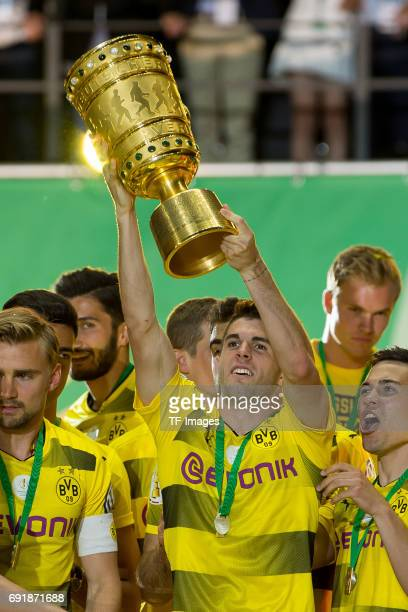 Christian Pulisic of Dortmund celebrates with the trophy after winning the DFB Cup final match between Eintracht Frankfurt and Borussia Dortmund at...