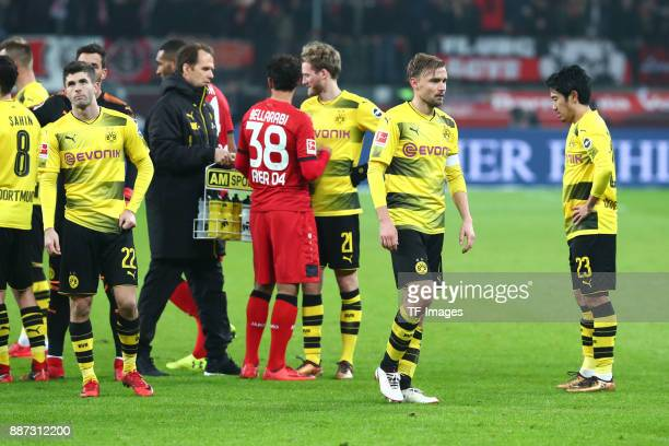 Christian Pulisic of Dortmund Goalkeeper Roman Bürki of Dortmund Andre Schuerrle of Dortmund Marcel Schmelzer of Dortmund and Shinji Kagawa of...