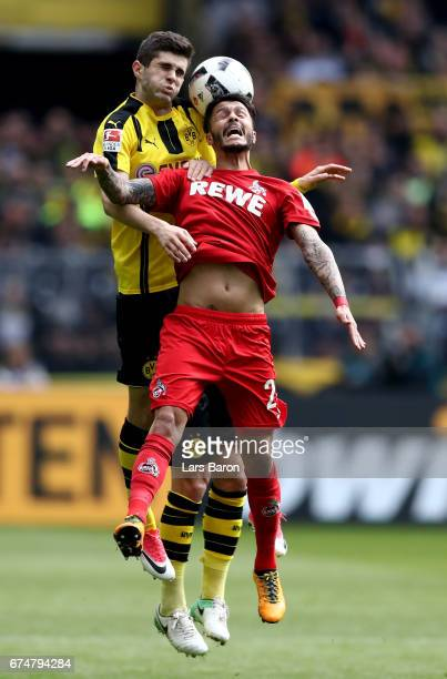 Christian Pulisic of Dortmund goes up for a header with Loureiro Bittencourt of Koeln during the Bundesliga match between Borussia Dortmund and 1 FC...