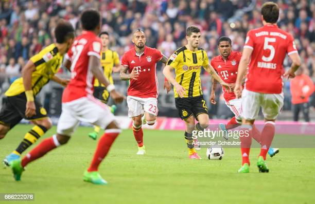 Christian Pulisic of Dortmund in action against Douglas Costa of Bayern Muenchen during the Bundesliga match between Bayern Muenchen and Borussia...