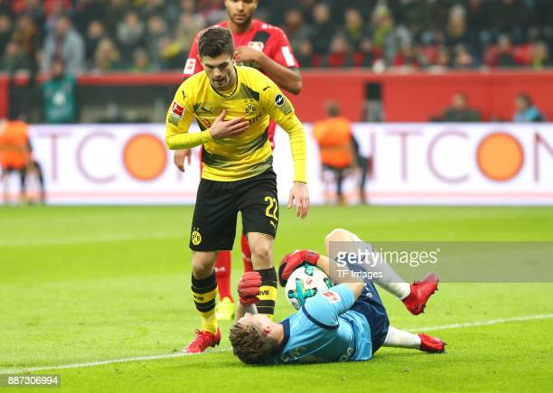 Christian Pulisic of Dortmund in action and Bernd Leno of Leverkusen on the ground during the Bundesliga match between Bayer 04 Leverkusen and...