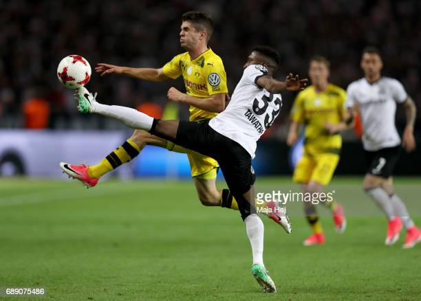 Christian Pulisic of Dortmund is challenged by Taleb Tawatha of Frankfurt during the DFB Cup final match between Eintracht Frankfurt and Borussia...