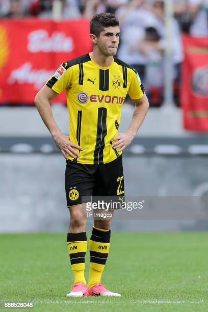 Christian Pulisic of Dortmund looks on during the Bundesliga match between FC Augsburg and Borussia Dortmund at the WWKArena on May 13 2017 in...