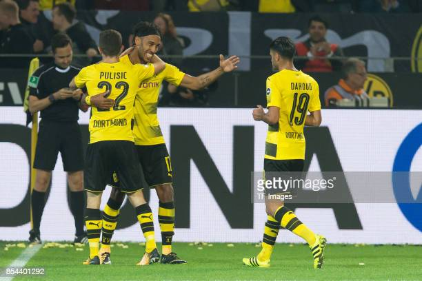 Christian Pulisic of Dortmund PierreEmerick Aubameyang of Dortmund and Mahmound Dahoud of Dortmund celebrate a goal during the Bundesliga match...