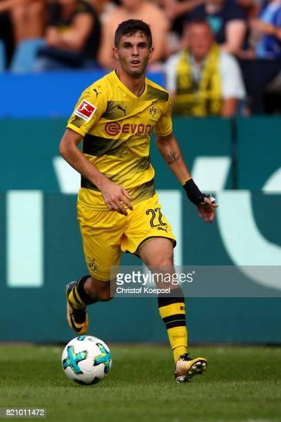Christian Pulisic of Dortmund runs with the ball during the preseason friendly match between VfL Bochum and Borussia Dortmund at Vonovia Ruhrstadion...