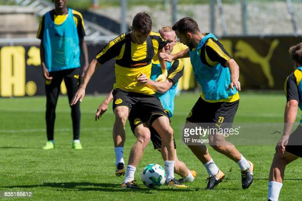 Christian Pulisic of Dortmund Sebastian Rode of Dortmund and Gonzalo Castro of Dortmund battle for the ball during a training session as part of the...