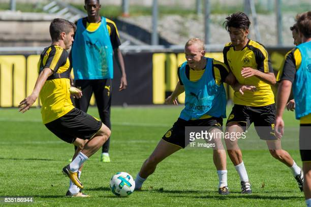 Christian Pulisic of Dortmund Sebastian Rode of Dortmund and Mahmound Dahoud of Dortmund battle for the ball during a training session as part of the...