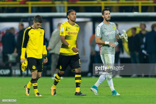 Christian Pulisic of Dortmund Sebastian Rode of Dortmund and Goalkeeper Roman Buerki of Dortmund looks dejected during the DFL Supercup 2017 match...