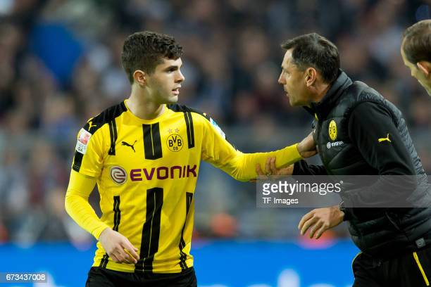 Christian Pulisic of Dortmund speak with Cocoach Arno Michels of Dortmund during the Bundesliga match between Borussia Dortmund and Hamburger SV at...