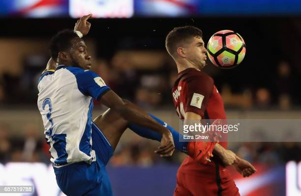 Christian Pulisic of the United States and Maynor Figueroa of Honduras go for the ball during their FIFA 2018 World Cup Qualifier at Avaya Stadium on...