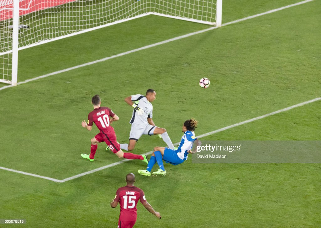 Christian Pulisic #10 of the United States attempts a shot which lead to a score Sebastian Lletget of the USA (not visible) during the FIFA 2018 World Cup Qualifier match between the United States and Honduras on March 24, 2017 at Avaya Stadium in San Jose, California. Other visible players include goalkeeper Donis Escober #22 and Henry Figueroa #4 of Honduras; and Darlington Nagbe #15 of the USA.
