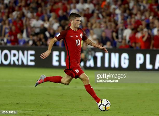 Christian Pulisic of the United States drive down field during the final round qualifying match against Panama for the 2018 FIFA World Cup at Orlando...
