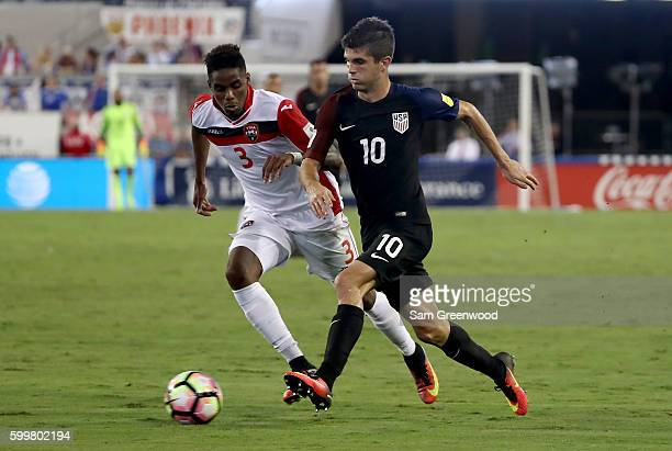 Christian Pulisic of the United States drives past Joevin Jones of Trinidad Tobago during the FIFA 2018 World Cup Qualifier at EverBank Field on...