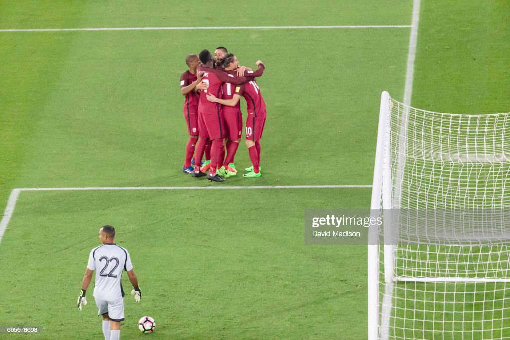 Christian Pulisic #10 of the United States is congratulated by teammates following his goal in the FIFA 2018 World Cup Qualifier match between the United States and Honduras on March 24, 2017 at Avaya Stadium in San Jose, California. Other visible players include goalkeeper Donis Escober #22 of Honduras.