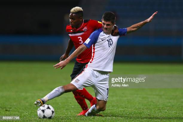 Christian Pulisic of the United States mens national team battles for control of the ball with Jovan Jones of Trinidad and Tobago during the FIFA...