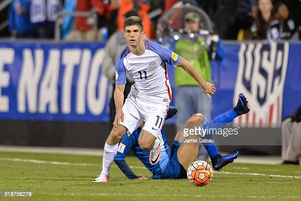 Christian Pulisic of the United States Men's National Team controls the ball against Guatemala during the FIFA 2018 World Cup qualifier on March 29...