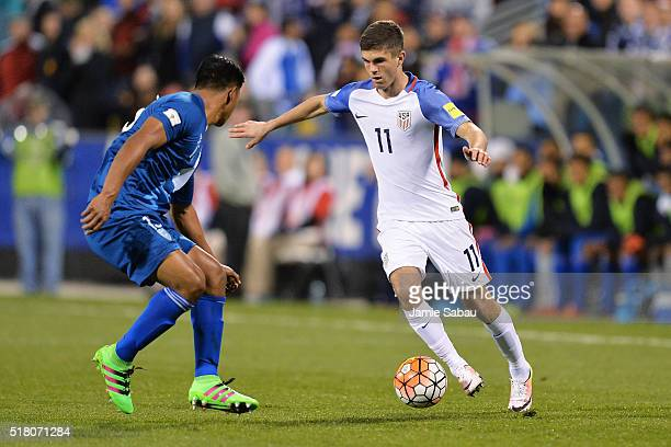 Christian Pulisic of the United States Men's National Team maneuvers with the ball against Carlos Castrillo of Guatemala in the second half during...