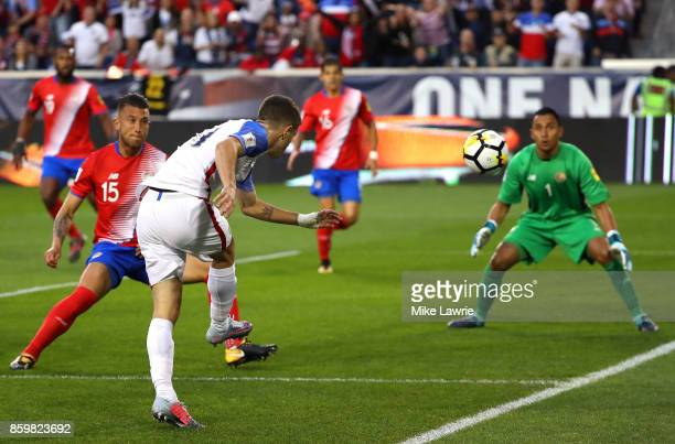 Christian Pulisic of the United States shoots against Keylor Navas of Costa Rica during the FIFA 2018 World Cup Qualifier at Red Bull Arena on...