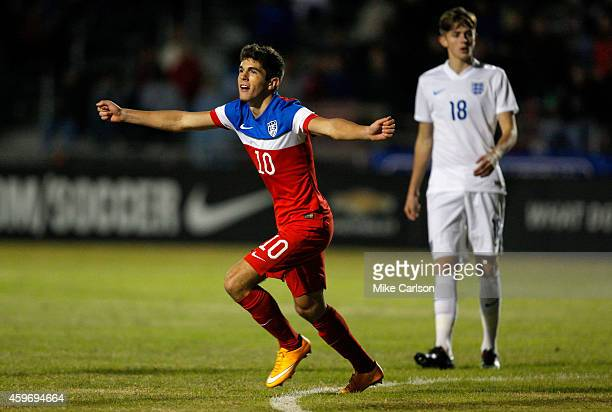 Christian Pulisic of United States celebrates his goal as William Patching of England reacts during the Nike International Friendlies at The Premier...