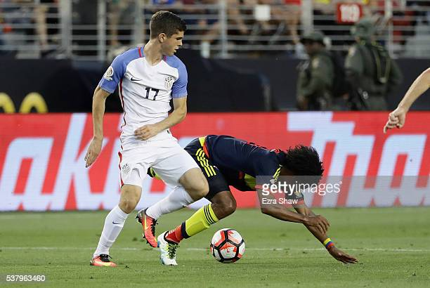Christian Pulisic of United States collides with Juan Cuadrado of Colombia during the 2016 Copa America Centenario Group match between the United...