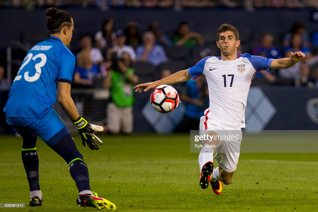 <a gi-track='captionPersonalityLinkClicked' href=/galleries/search?phrase=Christian+Pulisic&family=editorial&specificpeople=13768051 ng-click='$event.stopPropagation()'>Christian Pulisic</a> #17 of USA attempts to chip a pass past Guillermo Viscarra #23 of Bolivia late in the second half of the COPA America Centenario USA 2016 on May 28, 2016 at Children's Mercy Park in Kansas City, Kansas.