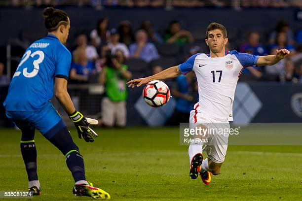 Christian Pulisic of USA attempts to chip a pass past Guillermo Viscarra of Bolivia late in the second half of an international friendly match...