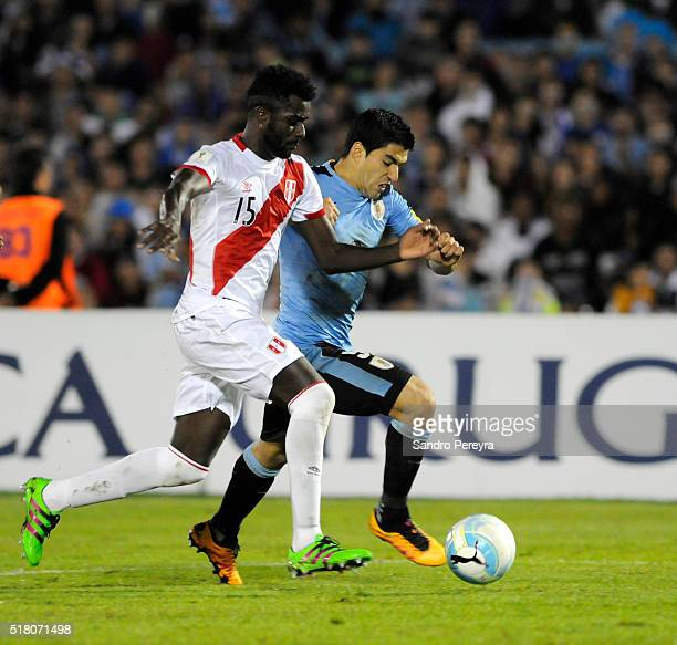 Christian Ramos of Peru and Luis Suarez of Uruguay fight for the ball during a match between Uruguay and Peru as part of FIFA 2018 World Cup...