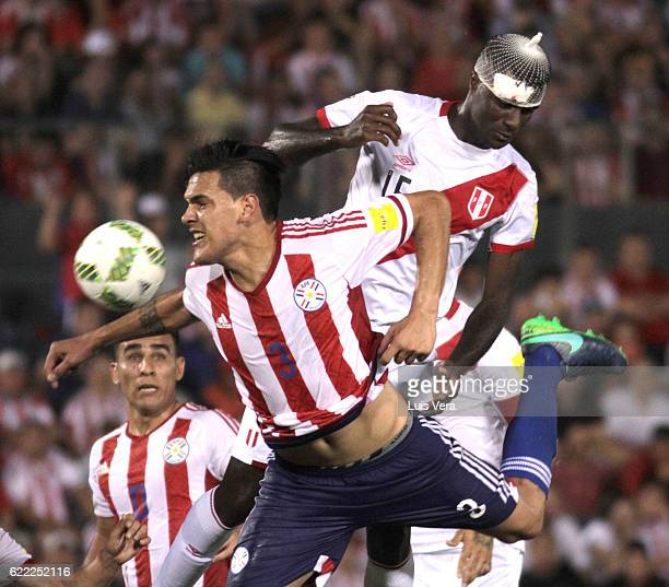 Christian Ramos of Peru jumps for the ball with Gustavo Gomez of Paraguay during a match between Paraguay and Peru as part of FIFA 2018 World Cup...