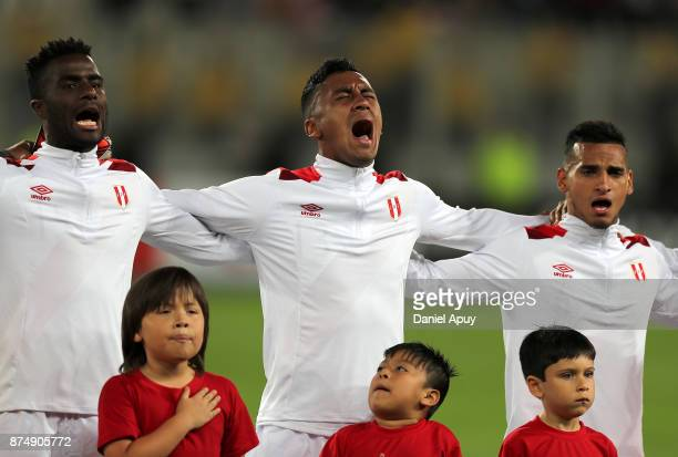 Christian Ramos Renato Tapia and Miguel Trauco of Peru sing their national anthem prior a second leg match between Peru and New Zealand as part of...