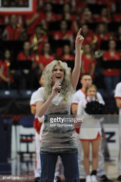 Christian recording artist Julianna Zobrist wife of Chicago Cubs World Series MVP Ben Zobrist sings the National Anthem prior to the Belmont Bruins...