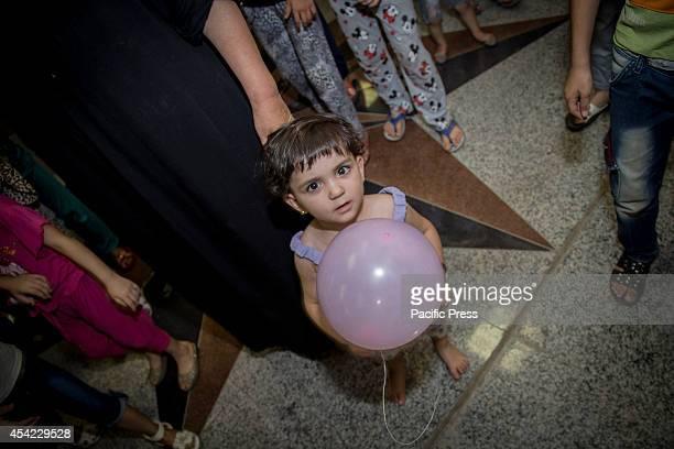 Christian refugee children take part in religious activities at Bazar International Shopping Mall Bazar International Shopping Mall is an unfinished...