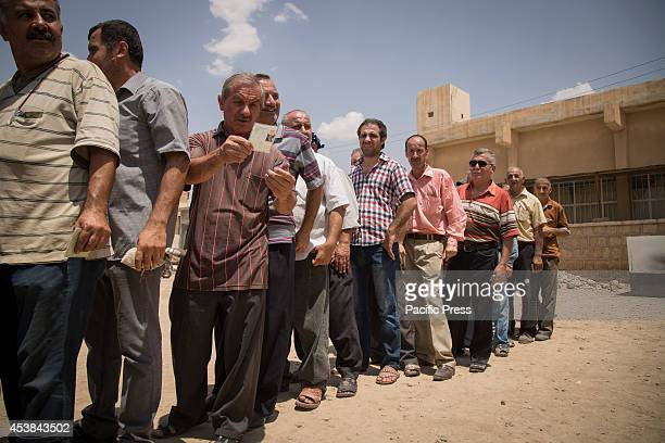 Christian refugees are waiting in line to receive stoves and gas bottles donated by the Barzani Foundation Qaraqosh Iraq