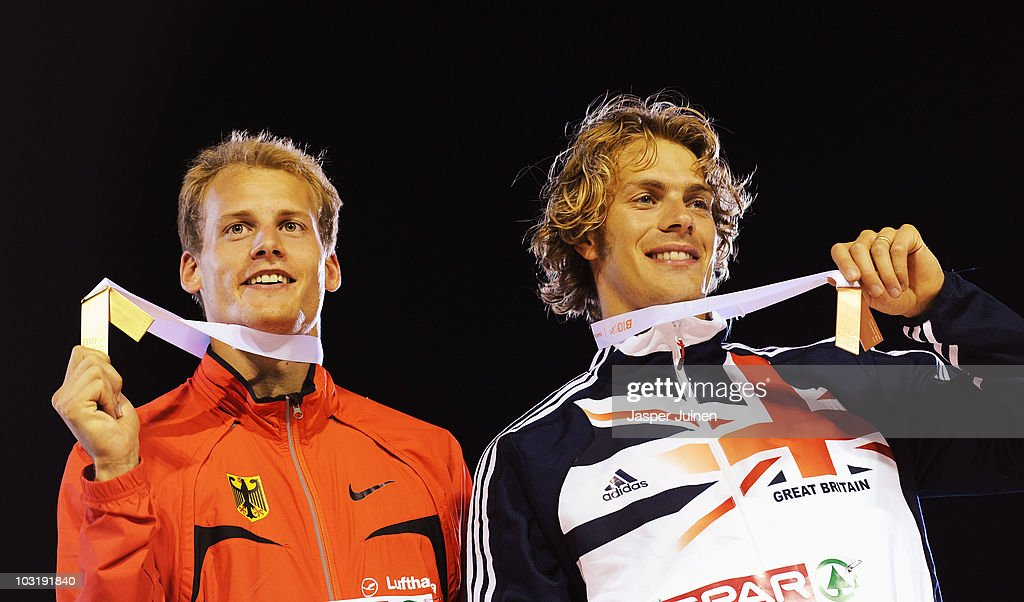 Christian Reif of Germany receives the gold medal and Chris Tomlinson of Great Britain receives the bronze medal in the Mens Long Jump during day six of the 20th European Athletics Championships at the Olympic Stadium on August 1, 2010 in Barcelona, Spain.