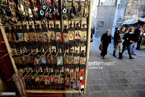 Christian religious icons are displayed at a handicrafts shop in the Syrian capital Damascus on February 4 2016 Syrian government troops moved closer...