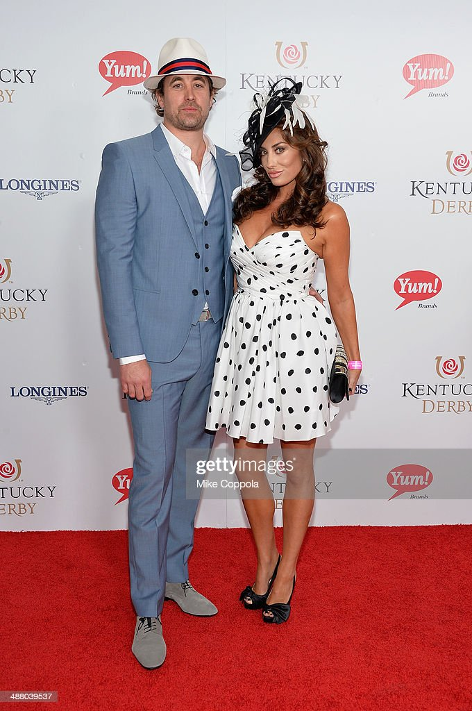 Christian Rovsek (L) and Elizabeth Rovsek attend 140th Kentucky Derby at Churchill Downs on May 3, 2014 in Louisville, Kentucky.