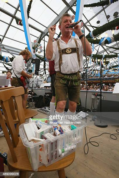 Christian Sachs conductor of the oldes Oktoberfest brass band 'Schwarzfischer' has a medicine box on his chair on stage on the opening day of the...