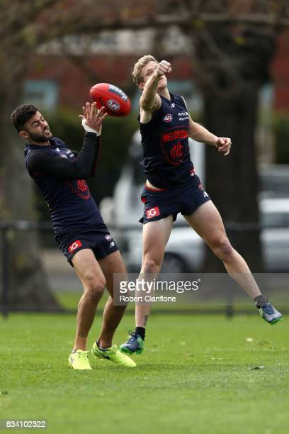 Christian Salem and Josh Wagner compete for a mark during a Melbourne Demons AFL training session at Gosch's Paddock on August 18 2017 in Melbourne...