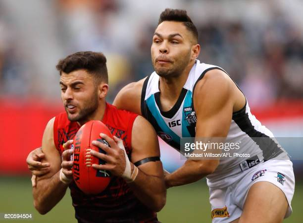 Christian Salem of the Demons and Jarman Impey of the Power compete for the ball during the 2017 AFL round 18 match between the Melbourne Demons and...