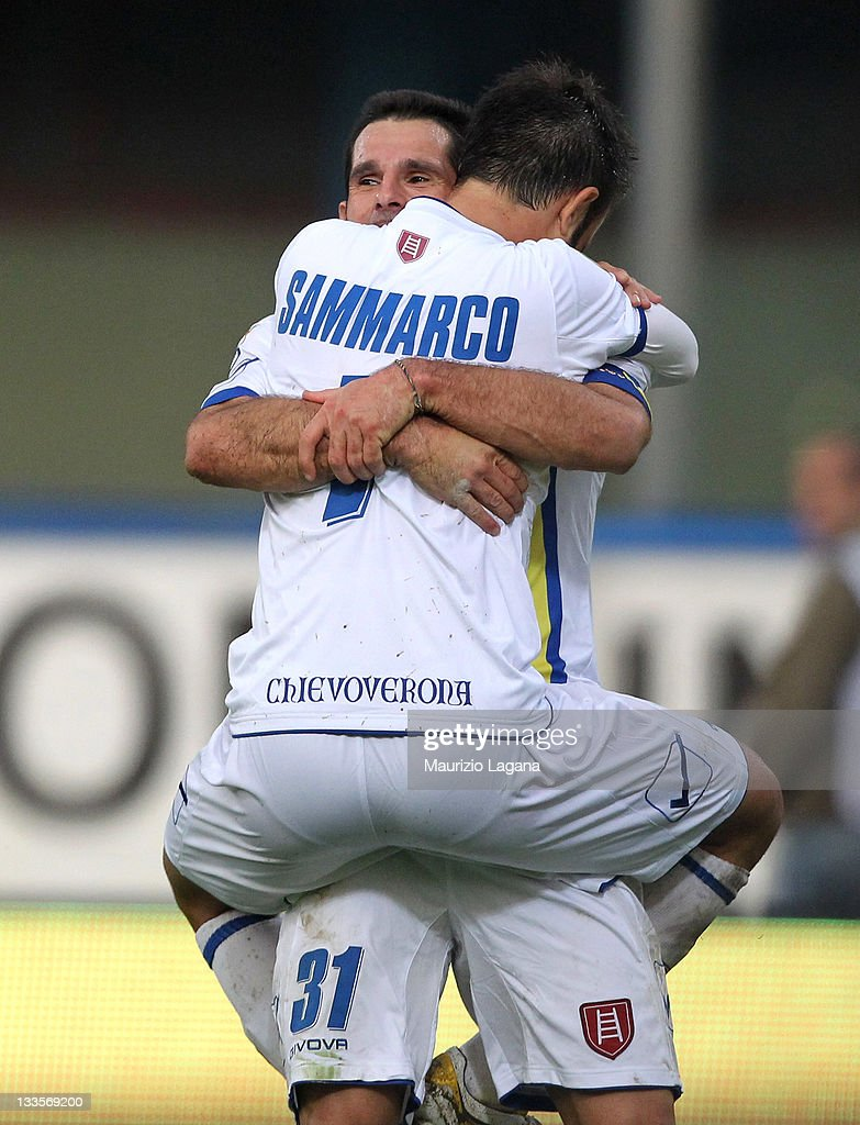 Christian Sammarco of Chievo celebrates his team's second goal with his teammate Sergio Pellisier during the Serie A match between Catania Calcio and...
