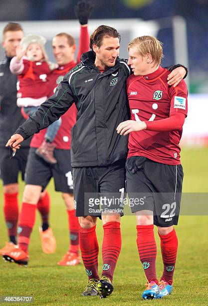 Christian Schulz and Rajtoral Frantisek of Hannover celebrate their teams win at the end of the Bundesliga match between Hannover 96 and Borussia...