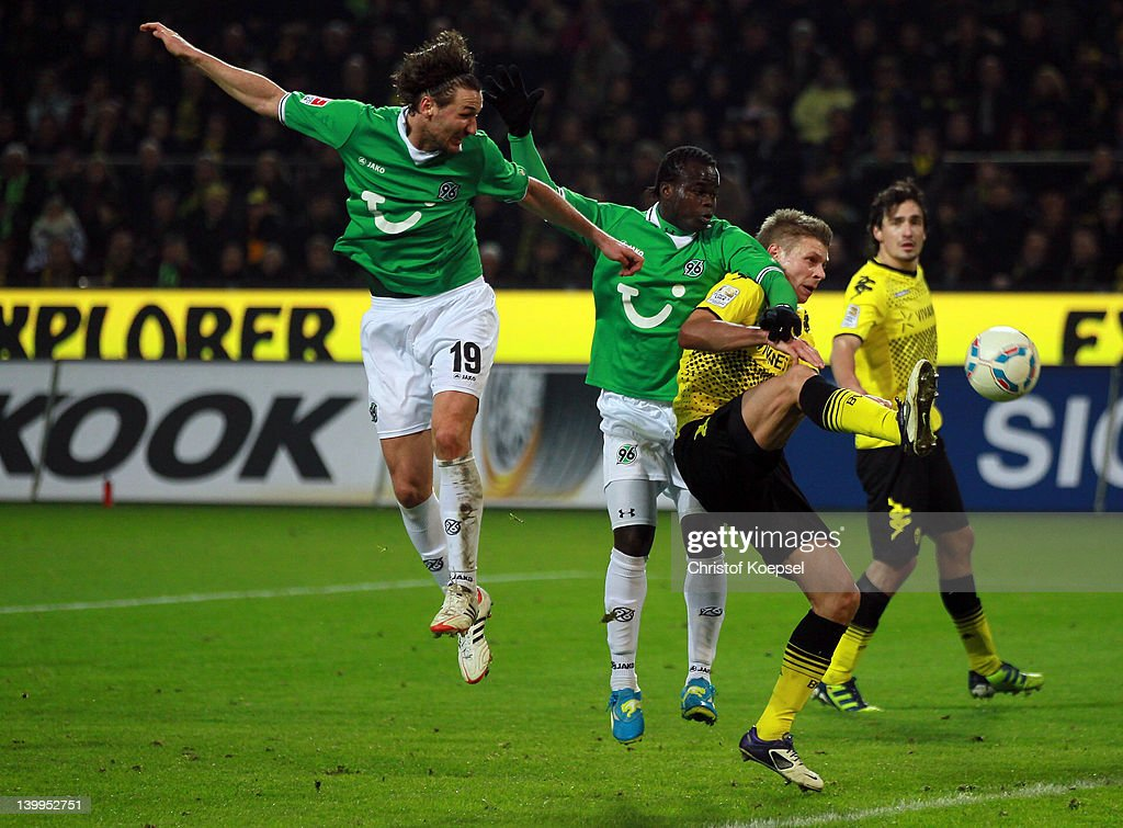 Christian Schulz Didier Ya Konan of Hannover and Lukasz Piszczek of Dortmund go up for a header during the Bundesliga match between Borussia Dortmund...