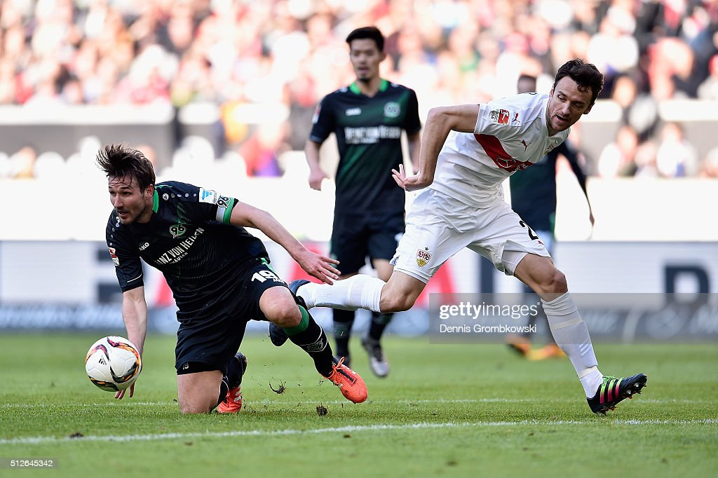 Christian Schulz of Hannover 96 and Christian Gentner of Vfb Stuttgart battle for the ball during the Bundesliga match between VfB Stuttgart and Hannover 96 at Mercedes-Benz Arena on February 27, 2016 in Stuttgart, Germany.
