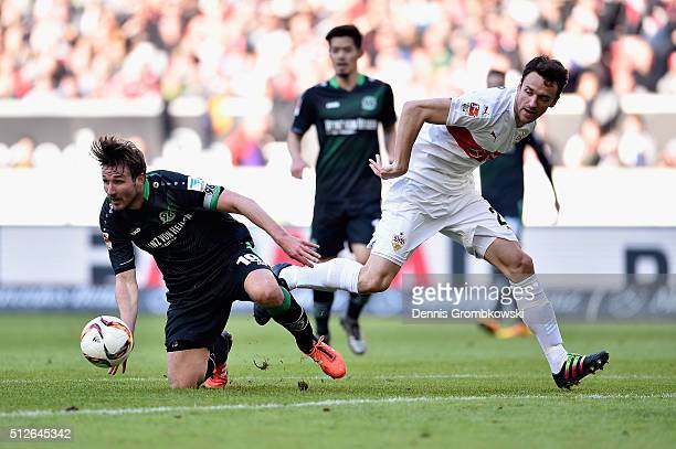 Christian Schulz of Hannover 96 and Christian Gentner of Vfb Stuttgart battle for the ball during the Bundesliga match between VfB Stuttgart and...