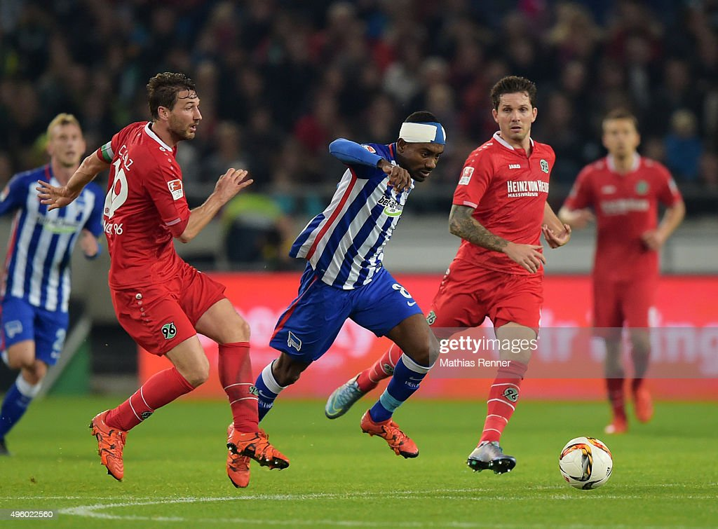 Christian Schulz of Hannover 96 and Salomon Kalou of Hertha BSC during the Bundesliga match between Hannover 96 and Hertha BSC at HDIArena on...