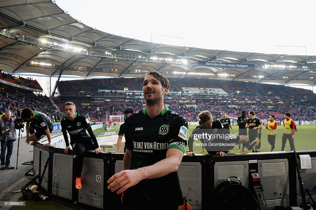 Christian Schulz of Hannover 96 celebrates their victory in the Bundesliga match between VfB Stuttgart and Hannover 96 at MercedesBenz Arena on...