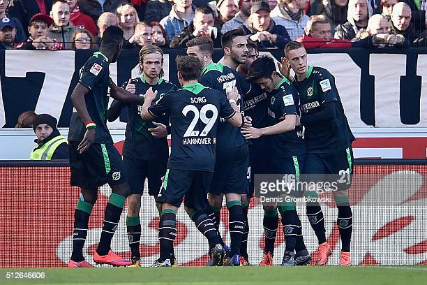 Christian Schulz of Hannover 96 celebrates with team mates as he scores their first goal during the Bundesliga match between VfB Stuttgart and...