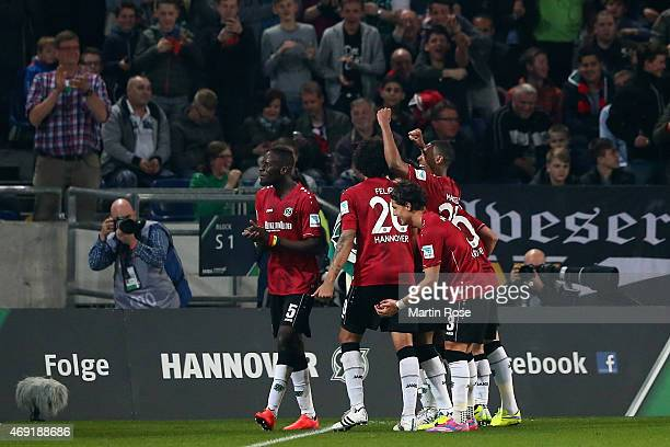 Christian Schulz of Hannover 96 celebrates with team mates as he scores the opening goal during the Bundesliga match between Hannover 96 and Hertha...