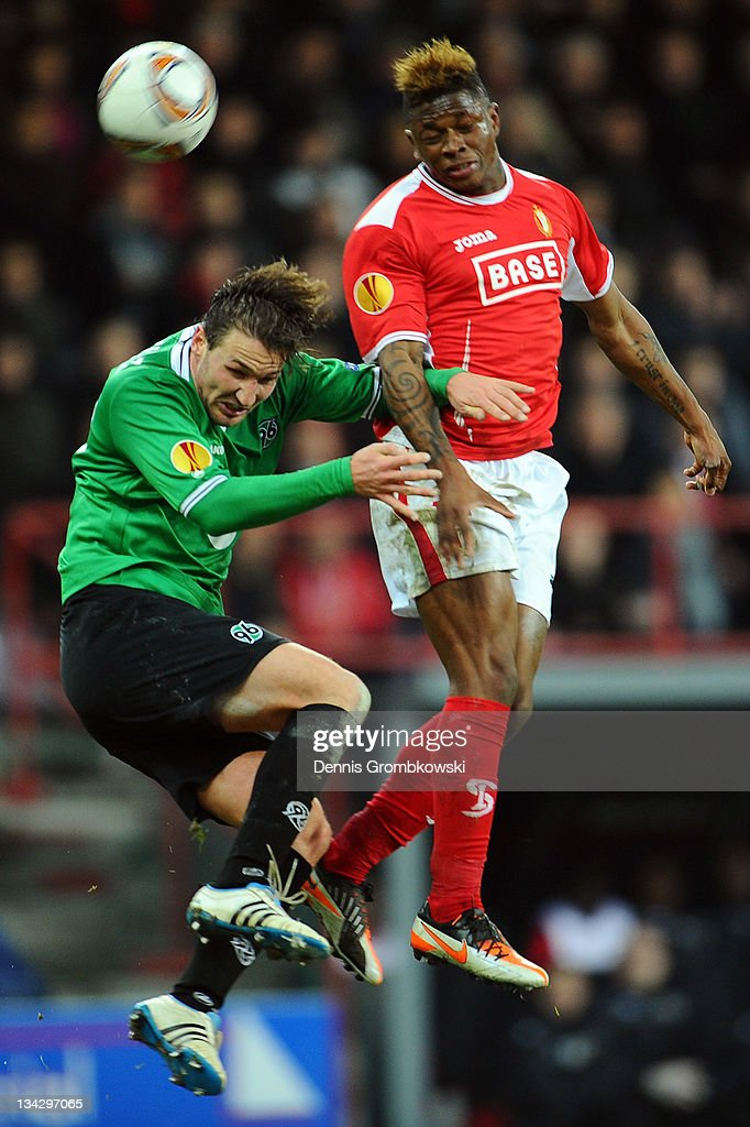 Christian Schulz of Hannover and Gohi Bi Cyriac of Liege jump for a header during the UEFA Europa League group B match between R Standard de Liege...